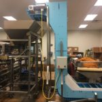 24 inch wide DynaClean Z Conveyor for mixing nuts