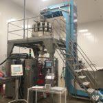 DynaClean Flat conveyor feeding Vertical Z Conveyor feeding a weigh scale