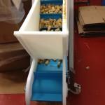 Food processing through an angular conveyor
