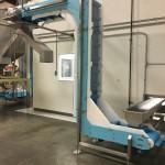 A DynaClean Vertical Z food grade incline conveyor