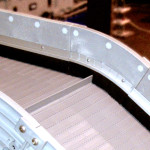 Conveyor sidewall brushes