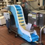 DynaClean incline conveyor with sliced potatoes