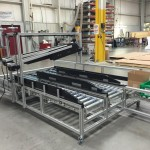 DynaCon box filling conveyors for a variety of different box or tote sizes.