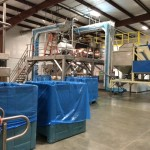 Vertical Z Conveyors at almond processor