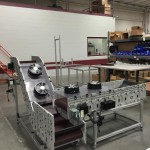 DynaCon custom conveyors with cooling fans.