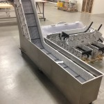 Water tank conveyor