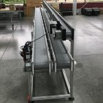 Three flat DynaCon conveyors incorporated for a co-packing operation