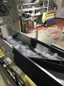 Plastic preforms on DynaCon conveyor